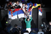 Novak Djokovic of Serbia poses with fans and the Norman Brookes Challenge Cup after winning the Men's Singles Final against Dominic Thiem of Austria on day fourteen of the 2020 Australian Open at Melbourne Park on February 02, 2020 in Melbourne, Australia.