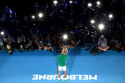 Novak Djokovic of Serbia kisses the Norman Brookes Challenge Cup after winning the Men's Singles Final against Dominic Thiem of Austria on day fourteen of the 2020 Australian Open at Melbourne Park on February 02, 2020 in Melbourne, Australia.