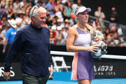 Caroline Wozniacki's coach and father Piotr Wozniacki walks alongside her after her Women's Singles third round match against Ons Jabeur of Tunisia day five of the 2020 Australian Open at Melbourne Park on January 24, 2020 in Melbourne, Australia.