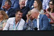 (L-R) Pat Cash, Jenny .Fitzgerald and Former Australian tennis player, John Fitzgerald watch on from the crowd inside Rod Laver Arena after John Fitzgerald was inducted into the Tennis Hall of Fame on day seven of the 2020 Australian Open at Melbourne Park on January 26, 2020 in Melbourne, Australia.