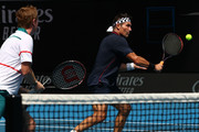 Pat Cash (R) plays a backhand with partner Mark Woodforde of Australia in their Men's Legends Doubles match against Thomas Muster of Austria and Mats Wilander of Sweden on day eight of the 2020 Australian Open at Melbourne Park on January 27, 2020 in Melbourne, Australia.