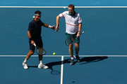 Pat Cash (L) and Mark Woodforde of Australia celebrate after winning a point in their Men's Legends Doubles match against Thomas Muster of Austria and Mats Wilander of Sweden on day eight of the 2020 Australian Open at Melbourne Park on January 27, 2020 in Melbourne, Australia.