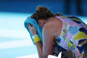 Petra Kvitova of Czech Republic towels down during her Women's Singles Quarterfinal match against Ashleigh Barty of Australia on day nine of the 2020 Australian Open at Melbourne Park on January 28, 2020 in Melbourne, Australia.