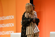 Halima Aden and Tory Burch embrace onstage during the 2020 Embrace Ambition Summit by the Tory Burch Foundation at Jazz at Lincoln Center on March 05, 2020 in New York City.