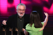 (L-R) Robert De Niro presents the Best Feature award for 'The Farewell' to Lulu Wang onstage during the 2020 Film Independent Spirit Awards on February 08, 2020 in Santa Monica, California.