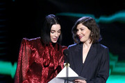 (L-R) St. Vincent and Carrie Brownstein speak onstage during the 2020 Film Independent Spirit Awards on February 08, 2020 in Santa Monica, California.