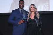 Winston Duke and Tiziana Rocca pose for a photo at the 2020 Filming Italy Awards at the Italian Cultural Institute on January 22, 2020 in Los Angeles, California.