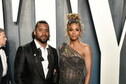 Russell Wilson and Ciara attend the 2020 Vanity Fair Oscar Party hosted by Radhika Jones at Wallis Annenberg Center for the Performing Arts on February 09, 2020 in Beverly Hills, California.