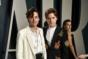 Cole Sprouse and Dylan Sprouse attends the 2020 Vanity Fair Oscar Party hosted by Radhika Jones at Wallis Annenberg Center for the Performing Arts on February 09, 2020 in Beverly Hills, California.