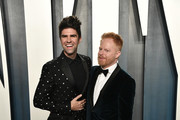Justin Mikita (L) and Jesse Tyler Ferguson attend the 2020 Vanity Fair Oscar Party hosted by Radhika Jones at Wallis Annenberg Center for the Performing Arts on February 09, 2020 in Beverly Hills, California.