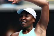 Venus Williams of The United States of America celebrates after winning match point in her Women's Singles first round match against Kirsten Flipkens of Belgium during day one of the 2021 Australian Open at Melbourne Park on February 08, 2021 in Melbourne, Australia.