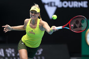Angelique Kerber of Germany plays a forehand in her Women's Singles first round match against Bernarda Pera of The United States of America during day one of the 2021 Australian Open at Melbourne Park on February 08, 2021 in Melbourne, Australia.