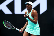 Venus Williams of The United States of America reacts in her Women's Singles first round match against Kirsten Flipkens of Belgium during day one of the 2021 Australian Open at Melbourne Park on February 08, 2021 in Melbourne, Australia.