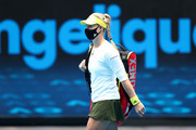 Angelique Kerber of Germany walks onto Margaret Court Arena wearing a face mask ahead of her Women's Singles first round match against Bernarda Pera of The United States of America during day one of the 2021 Australian Open at Melbourne Park on February 08, 2021 in Melbourne, Australia.