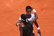Mikael Ymer of Sweden embraces Gael Monfils of France after winning his mens second round match during day five of the 2021 French Open at Roland Garros on June 03, 2021 in Paris, France.