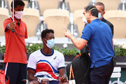 Gael Monfils of France speaks with officals during an injury break during his mens second round match against Mikael Ymer of Sweden during day five of the 2021 French Open at Roland Garros on June 03, 2021 in Paris, France.