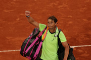 Rafael Nadal of Spain waves to the crowd as he leaves the court after losing his Men's Singles Semi Final match against Novak Djokovic of Serbia on day Thirteen of the 2021 French Open at Roland Garros on June 11, 2021 in Paris, France.