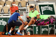 Rafael Nadal of Spain receives medical attention during his Men's Singles Semi Final match against Novak Djokovic of Serbia on day Thirteen of the 2021 French Open at Roland Garros on June 11, 2021 in Paris, France.