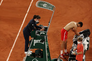 Rafael Nadal of Spain picks up his bags  as he leaves the court after losing his Men's Singles Semi Final match against Novak Djokovic of Serbia on day Thirteen of the 2021 French Open at Roland Garros on June 11, 2021 in Paris, France.