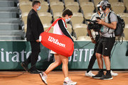 Carla Suarez Navarro of Spain leaves the court following defeat in their ladies first round match against Sloane Stephens of The United States during day three of the 2021 French Open at Roland Garros on June 01, 2021 in Paris, France.