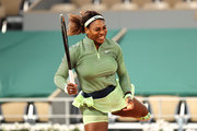 Serena Williams of The United States reacts in their ladies singles first round match against Irina-Camelia Begu of Romania on day two of the 2021 French Open at Roland Garros on May 31, 2021 in Paris, France.
