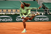 Serena Williams of The United States serves in their ladies singles first round match against Irina-Camelia Begu of Romania on day two of the 2021 French Open at Roland Garros on May 31, 2021 in Paris, France.