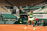 Serena Williams of The United States in their ladies singles first round match against Irina-Camelia Begu of Romania in-front of an empty stadium due to COVID-19 restrictions in France on day two of the 2021 French Open at Roland Garros on May 31, 2021 in Paris, France.