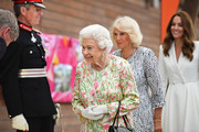 (L-R) Queen Elizabeth II, Camilla, Duchess of Cornwall and Catherine, Duchess of Cambridge arrive to attend an event in celebration of The Big Lunch initiative at The Eden Project during the G7 Summit on June 11, 2021 in St Austell, Cornwall, England. UK Prime Minister, Boris Johnson, hosts leaders from the USA, Japan, Germany, France, Italy and Canada at the G7 Summit. This year the UK has invited India, South Africa, and South Korea to attend the Leaders' Summit as guest countries as well as the EU.