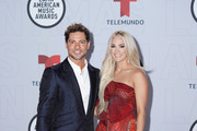 (L-R) David Bisbal and Carrie Underwood attend the 2021 Latin American Music Awards at BB&T Center on April 15, 2021 in Sunrise, Florida.