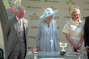 Prince Charles, Prince of Wales (L) and Camilla, Duchess of Cornwall (C) award jockey Kevin Manning after he won the St James's Palace Stakes on Poetic Flare during Royal Ascot 2021 at Ascot Racecourse on June 15, 2021 in Ascot, England.