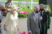 Prince Charles, Prince of Wales (R) and Camilla, Duchess of Cornwall (L) present the Prince Of Wales's Stakes during Royal Ascot 2021 at Ascot Racecourse on June 16, 2021 in Ascot, England.