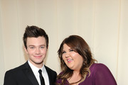 Actors Ashley Fink (R) and Chris Colfer arrive at the 20th Annual Elton John AIDS Foundation Academy Awards Viewing Party at The City of West Hollywood Park on February 26, 2012 in Beverly Hills, California.