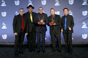 Luis Enrique and C4 trío pose with awards for Best Arrangement and Best Folk Album in the press room during the 20th annual Latin GRAMMY Awards at MGM Grand Garden Arena on November 14, 2019 in Las Vegas, Nevada.