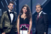 Luis Gerardo Méndez, Alessia Cara and Cristian Nodal present the Tropical Fusion Album Award onstage during the 20th annual Latin GRAMMY Awards at MGM Grand Garden Arena on November 14, 2019 in Las Vegas, Nevada.