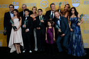 (L-R) Actors Ty Burrell, Sarah Hyland, Ed O'Neill, Nolan Gould, Julie Bowen, Rico Rodriguez, Aubrey Anderson-Emmons, Eric Stonestreet, Jesse Tyler Ferguson, Sofia Vergara, and Ariel Winter, winners of Outstanding Performance by an Ensemble in a Comedy Series for 'Modern Family,' pose in the press room during the 20th Annual Screen Actors Guild Awards at The Shrine Auditorium on January 18, 2014 in Los Angeles, California.