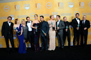 (L-R) Writer-director David O. Russell, actors Amy Adams, Colleen Camp, Alessandro Nivola, Jennifer Lawrence, Michael Pena, Elisabeth Rohm, Jeremy Renner, Paul Herman, Bradley Cooper, and Robert De Niro, winners of the Outstanding Performance by a Cast in a Motion Picture award for 'American Hustle,' pose in the press room during the 20th Annual Screen Actors Guild Awards at The Shrine Auditorium on January 18, 2014 in Los Angeles, California.
