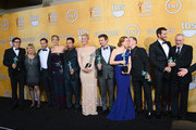 (L-R) Writer-director David O. Russell, actors Colleen Camp, Alessandro Nivola, Jennifer Lawrence, Michael Pena, Elisabeth Rohm, Jeremy Renner, Amy Adams, Paul Herman, Bradley Cooper, and Robert De Niro, winners of the Outstanding Performance by a Cast in a Motion Picture award for 'American Hustle,' pose in the press room during the 20th Annual Screen Actors Guild Awards at The Shrine Auditorium on January 18, 2014 in Los Angeles, California.