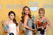 (L-R) Actresses Sarah Hyland, Sofia Vergara, and Julie Bowen, winners of the Outstanding Performance by an Ensemble in a Comedy Series for 'Modern Family,' pose in the press room during the 20th Annual Screen Actors Guild Awards at The Shrine Auditorium on January 18, 2014 in Los Angeles, California.