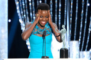 Actress Lupita Nyong'o accepts the Outstanding Performance by a Female Actor in a Supporting Role award for '12 Years a Slave' onstage during the 20th Annual Screen Actors Guild Awards at The Shrine Auditorium on January 18, 2014 in Los Angeles, California.