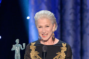 Actress Helen Mirren accepts the Outstanding Performance by a Female Actor in a Miniseries or Television Movie award for 'Phil Spector' onstage during the 20th Annual Screen Actors Guild Awards at The Shrine Auditorium on January 18, 2014 in Los Angeles, California.