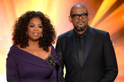 Actress-TV personality Oprah Winfrey and actor Forest Whitaker speak onstage during the 20th Annual Screen Actors Guild Awards at The Shrine Auditorium on January 18, 2014 in Los Angeles, California.