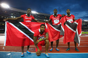 Silver medalists Keston Bledman, Marc Burns, Rondel Sorrillo and Richard Thompson of Trinidad and Tobago  pose after Men's 4 x 100m Relay Final at Hampden Park during day ten of the Glasgow 2014 Commonwealth Games on August 2, 2014 in Glasgow, United Kingdom.