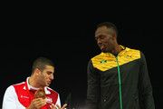 Silver medalist Adam Gemili of England talks to gold medalist Usain Bolt of Jamaica during the medal ceremony for the Men's 4x100 metres relay  at Hampden Park during day ten of the Glasgow 2014 Commonwealth Games on August 2, 2014 in Glasgow, United Kingdom.