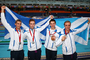 (L-R) Silver medallists Stephen Milne, Daniel Wallace, Duncan Scott and Robbie Renwick of Scotland pose after the medal ceremony for the Men's 4 x 200m Freestyle Relay Final at Tollcross International Swimming Centre during day four of the Glasgow 2014 Commonwealth Games on July 27, 2014 in Glasgow, Scotland.