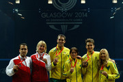 (L-R) Peter Barker and Alison Waters of England (silver) David Palmer and Rachael Grinham of Australia (gold) Cameron Pilley and Kasey Brown of Australia (bronze) pose with their medals after the Mixed Squash Doubles Gold Medal Match at Scotstoun Sports Campus during day eleven of the Glasgow 2014 Commonwealth Games on August 3, 2014 in Glasgow, United Kingdom.