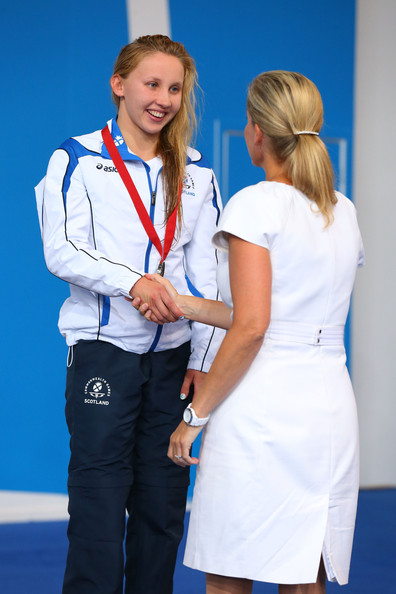 Bronze medallist Corrie Scott of Scotland is presented her medal by Sophie, Countess of Wessex during the medal ceremony for the Women's 50m Breaststroke Final at Tollcross International Swimming Centre during day two of the Glasgow 2014 Commonwealth Games on July 25, 2014 in Glasgow, Scotland.
