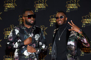 (L-R) Maitre Gims and Dadju arrive at the 20th NRJ Music Awards at Palais des Festivals on November 10, 2018 in Cannes, France.