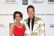 Ghada Dergham (L) and David Bromstad arrive at the 21st Annual Elton John AIDS Foundation's Oscar Viewing Party on February 24, 2013 in Los Angeles, California.