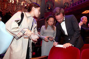 Actor Aaron Paul signs autographs during the 21st Annual Huading Global Film Awards at The Theatre at Ace Hotel on December 15, 2016 in Los Angeles, California.