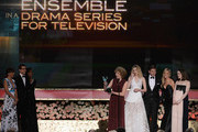 Actors Phyllis Logan, Laura Carmichael, Allen Leech, Joanne Froggatt, and Sophie McShera accept the award for Outstanding Performance by an Ensemble in a Drama Series onstage from Andy Samberg and Rashida Jones (far left) at the 21st Annual Screen Actors Guild Awards at The Shrine Auditorium on January 25, 2015 in Los Angeles, California.
